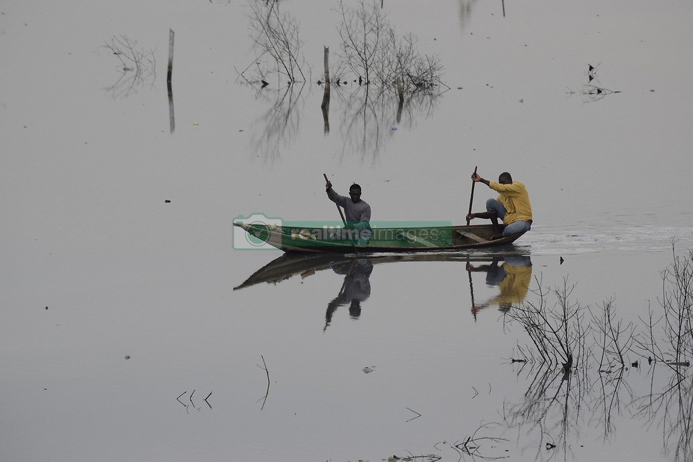 August 7, 2017 - Lagos, Nigeria - Fishermen paddle canoe on the Lagoon at Iyana-Oworo in Lagos, Nigeria, Monday August 7, 2017. (Credit Image: © Adekunle Ajayi/NurPhoto via ZUMA Press)