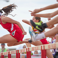 050914       Cable Hoover<br /> <br /> Monument Valley Mustang Kaitlyn Wayne pulls away from the competition to win her heat in the 110-meter hurdles during the Arizona State Track Meet at Mesa Community College in Mesa Friday.