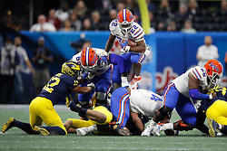 Florida Gators running back Lamical Perine #22 leaps the pile during the Chick-fil-A Peach Bowl, Saturday, December 29, 2018, in Atlanta. ( Paul Abell via Abell Images for Chick-fil-A Peach Bowl)
