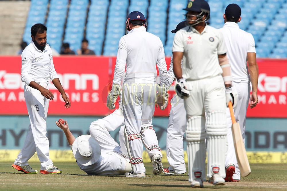 Ben Stokes, Adil Rashid of England celebrates the wicket of Umesh Yadav of India during day 4 of the first test match between India and England held at the Saurashtra Cricket Association Stadium , Rajkot on the 12th November 2016.<br /> <br /> Photo by: Deepak Malik/ BCCI/ SPORTZPICS