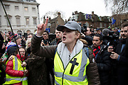 Vote Leave demonstrator shouts at Anti Brexit pro Europe demonstrators in Westminster on the day of the 'meaningful vote' when MPs will back or reject the Prime Minister's Brexit Withdrawal Agreement on 15th January 2019 in London, England, United Kingdom.
