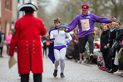 © Licensed to London News Pictures. 13/02/2018. The three hundredth (300) run of the annual Shrove Tuesday Pancake race took place in the centre of Lichfield. The race has run uninterrupted even through both world wars. Pictured, the fancy dress heats. Photo credit: Dave Warren/LNP