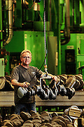 Volvo Technician ready to mill a raw truck engine crankshaft