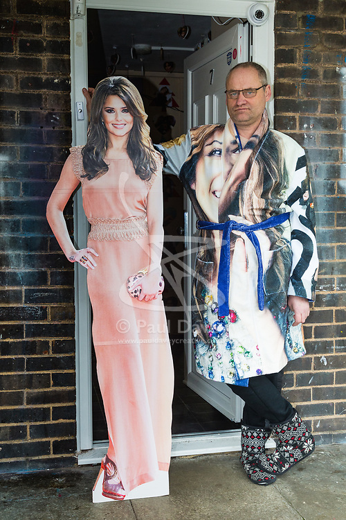 Shaun Smith, 52, from Basildon in Essex poses outside his from door with a cut-out of his idol, Cheryl Cole. He has built up a huge collection of Cheryl Cole memorabilia in the space of about eight months after she impressed him in a music video he was watching.. PLACE, January 24 2019.