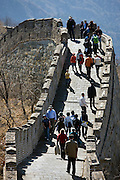 Tourists walk the ancient Great Wall of China at Mutianyu, north of Beijing, China