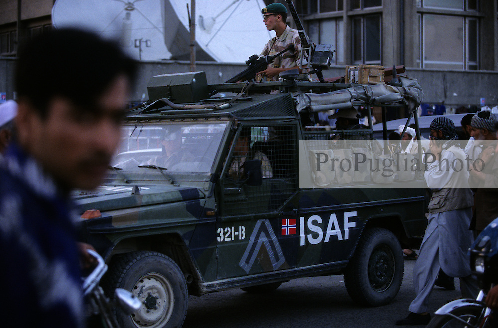 Kabul, 17 July 2005..Danish ISAF troop, on board of a military  vehicle, patrolling the street of the Afghan's capital.