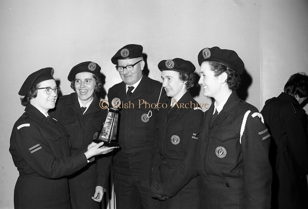 27/3/1966<br /> 3/27/1966<br /> 27 March 1966<br /> <br /> Miss. A. Meyler(left) Leader of the Winning Crumlin Team, showing the Gold Flake Trophy to(L-R) Mrs. F. Rigney, Leader Dundrum;Mr Michael O'Brien C.D.O Dublin; Miss Sheila Purdue Leader, Finglas team; Miss Barbra Hughes, Leader, Clonartf Team after the Competitions.