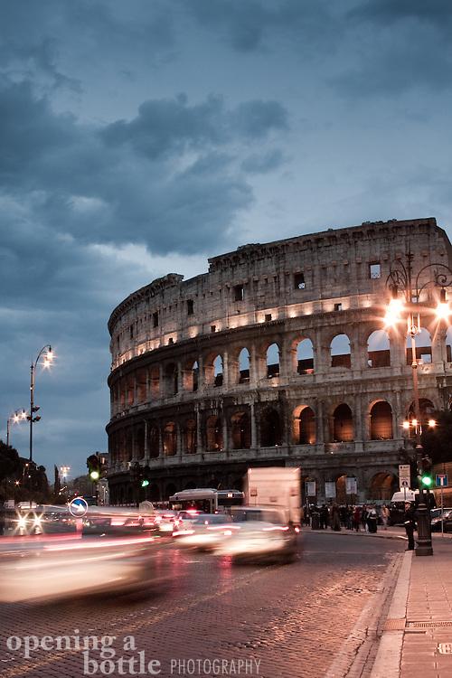 The Roman Coliseum and Via dei Fori Imperiali shortly after sunset, Rome, Lazio, Italy.
