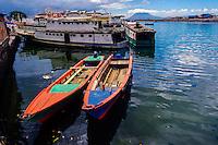 Indonesia, Sulawesi, Manado. Colourful boats in Manado harbour.