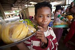 Friendly young fruit vendor