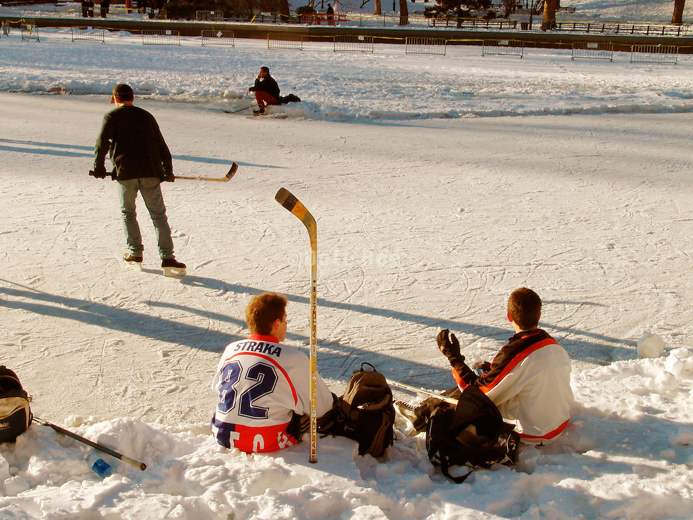 Resting after a friendly game of ice hockey.