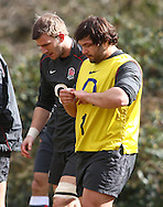 Alex Corbisiero inspects his left little finger which he appeared to hurt during the England elite player squad rugby training session at Pennyhill Park, Bagshot, Surrey, UK on 11 March 2011. The England team play Scotland on Sunday 13th March at Twickenham. (Photo by Andrew Tobin/Focus Images)