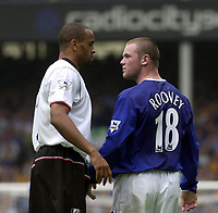 Photo: Greig Cowie.<br /> 23/08/2003.<br /> FA Barclaycard Premiership. Everton v Fulham. Goodison Park.<br /> Wayne Rooney back and as confrontational as ever with Alain Goma