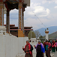 Asia, Bhutan, Thimpu. Women circumambulating the Memorial Chorten.