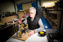 "© Licensed to London News Pictures. 27/11/2016. Leeds UK. Picture shows Ian Teasdale testing the vinyl mechanism for the  Rocket jukebox, the only vinyl playing jukebox being produced in the world. A resurgence in the popularity of Vinyl has prompted Leeds based Jukebox manufacturer Sound Leisure to build a new Vinyl playing Jukebox called the Rocket making them the only company in the world building a jukebox that play's vinyl record's. The first of the new Jukeboxes have started to roll of the production line in Yorkshire at a cost of £8,000 & can play 140 songs. The Rocket hold's 70 7"" record's on a rotating mechanism, has a D4 amplifier with a 60W output & a remote control. Demand for the Rocket is high with order's from across the globe. Photo credit: Andrew McCaren/LNP"