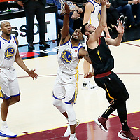 OAKLAND, CA - JUN 3: Larry Nance Jr. #22 of the Cleveland Cavaliers goes for the reverse layup past Andre Iguodala #9 of the Golden State Warriors in Game Three of the 2018 NBA Finals won 110-102 by the Golden State Warriors over the Cleveland Cavaliers at the Quicken Loans Arena on June 6, 2018 in Cleveland, Ohio. NOTE TO USER: User expressly acknowledges and agrees that, by downloading and or using this photograph, User is consenting to the terms and conditions of the Getty Images License Agreement. Mandatory Copyright Notice: Copyright 2018 NBAE (Photo by Chris Elise/NBAE via Getty Images)