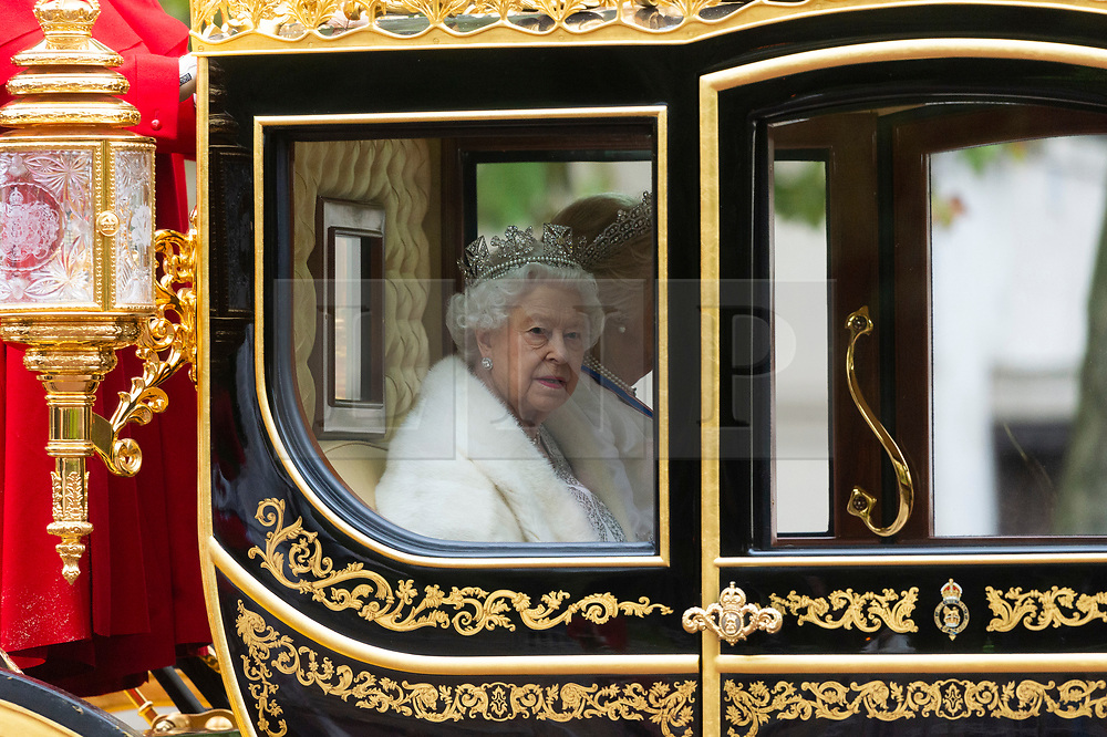 © Licensed to London News Pictures. 14/10/2019. London, UK. Queen Elizabeth II travels in a carriage along The Mall to the Houses of Parliament to give The Queens Speech. The speech marks the state opening of Parliament and a new Parliamentary Session. Photo credit: Ray Tang/LNP