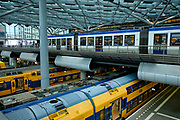 The Hague, South-Holland/Netherlands - 01152020: Trains and tram in The Hague Central Station
