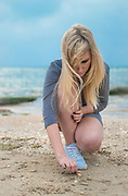 contemplating Young blonde woman on the beach