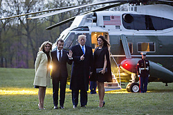 U.S. First Lady Melania Trump, from right, U.S. President Donald Trump, Emmanuel Macron, France's president, and Brigitte Macron, France's first lady, stand for photographers in front of Marine One after a dinner at the Mount Vernon estate of first U.S. President George Washington in Mount Vernon, Virginia, U.S., on Monday, April 23, 2018. As Macron arrives for the first state visit of Trump's presidency, the U.S. leader is threatening to upend the global trading system with tariffs on China, maybe Europe too. Photographer: Andrew Harrer/Bloomberg