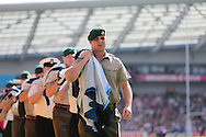 Soldiers carry the RWC2015 flag before the Rugby World Cup 2015 match between Samoa and USA at the Brighton Community Stadium, Falmer, United Kingdom on 20 September 2015.