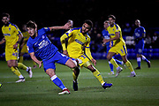Peterborough United midfielder Alex Woodyard (4) and AFC Wimbledon midfielder Andy Barcham (17) during the EFL Sky Bet League 1 match between Peterborough United and AFC Wimbledon at The Abax Stadium, Peterborough, England on 27 November 2018.