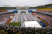 Approximately 30,000 couples get married in a Unification Church mass wedding ceremony at RFK Stadium November 29, 1997 in Washington, DC.