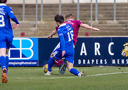 06MAR21 Arbroath's Jason Thomson brought down by Queen of the South's Euan East for their penalty. Arbroath 2 v 4 Queen of the South, Scottish Championship played 6/3/2021 at Arbroath's home ground, Gayfield Park.
