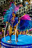 Performers on floats in the Carnaval parade of Unidos da Ponte samba school in the Sambadrome, Rio de Janeiro, Brazil.