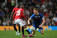 Rochdale's Callum Camps is tackled by Manchester United's Aaron Wan-Bissaka during the EFL Cup match between Manchester United and Rochdale at Old Trafford, Manchester, England on 25 September 2019.