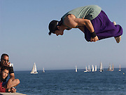 04 April 2012-Santa Barbara, CA: A group of Free Runners practice their jumps, flips, spins along the Breakwater of Santa Barbara Harbor.  Photo by Rod Rolle