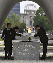 71. Jahrestag des Atombombenabwurfs in Hiroshima / 060816<br /> <br /> ***Hiroshima Mayor Kazumi Matsui (R) dedicates a list of U.S. atomic bombing victims at the cenotaph at the Peace Memorial Park on Aug. 6, 2016, the 71st anniversary of the bombing***