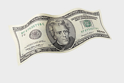 wavy 20 001 United States twenty dollar bill floating on air with a white background