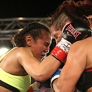 Nydia Feliciano (L) and Noemi Bosques square off during a Telemundo Boxeo boxing match at the A La Carte Pavilion on Friday,  March 13, 2015 in Tampa, Florida.  Feliciano won the bout by split decision. (AP Photo/Alex Menendez)