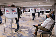 03 NOVEMBER 2020 - WEST DES MOINES, IOWA: Poll watchers (right) watch voters at the West Des Moines Marriott on Election Day in West Des Moines. Voter turnout was heavy at most polling places in the Des Moines metro area.       PHOTO BY JACK KURTZ