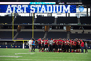 The Iraan High School football team huddle during a time out in the state championship game at AT&T Stadium in Arlington, Texas on December 15, 2016. (Cooper Neill for The New York Times)