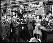 Newly Elected TD Enda Kenny Arrives at The Dail..(J89)..1975..18.11.1975..11.18.1975..18th November 1975..Following the death of his father,Henry Kenny TD, Enda Kenny was proposed by the Fine Gael party to contest the seat. He was duly elected and went to Dublin to take up his seat in Dail Eireann at Leinster House, Dublin. .Image of Enda Kenny being held aloft by supporters, many of whom had travelled by bus from Mayo to attend his first day as a T.D.
