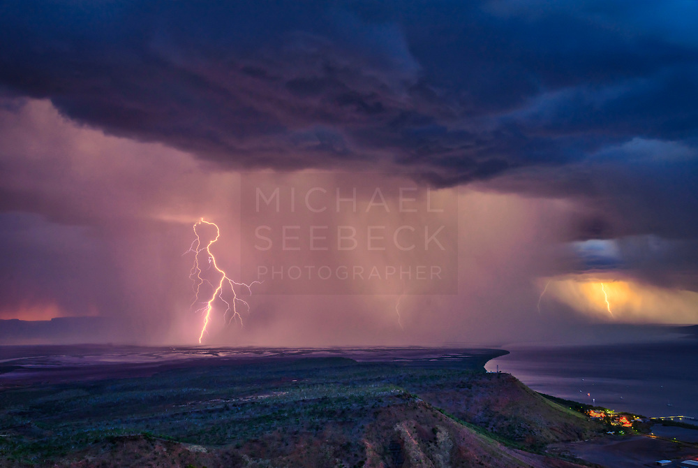 A Thunderstprm passes to the south of the Five Rivers Lookout, dropping intense lightning bolts over the mudflats of the King River estuary. Part of Wyndham is visible on the right.<br /> <br /> Code: LAWK0137<br /> <br /> Available as an open edition print and stock image.<br /> <br /> Add to Cart to view options and pricing.