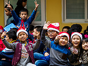 "22 DECEMBER 2017 - HANOI, VIETNAM:  Children at a school Christmas party in the old quarter of Hanoi. The old quarter is the heart of Hanoi, with narrow streets and lots of small shops but it's being ""gentrified"" because of tourism and some of the shops are being turned into hotels and cafes for tourists and wealthy Vietnamese.   PHOTO BY JACK KURTZ"