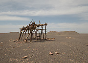 Used for shade, an old wooden structure near a Qanat (traditional well).