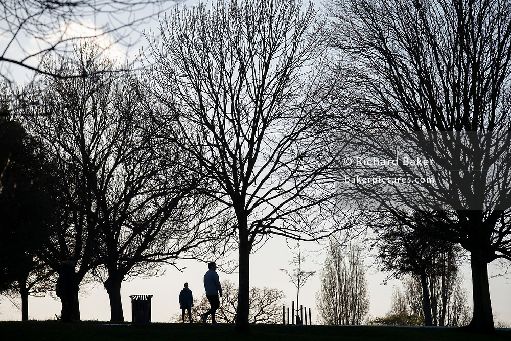 South Londoners out for a late-afternoon walk, enjoy the last sunlight during the second lockdown of the Cornavirus pandemic, in Brockwell Park, on 19th November 2020, in Lambeth, London, England.