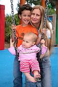 Mum & children in kids playground