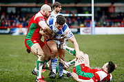 Keighley Cougars centre Adam Ryder (4) tackles Workington Town centre Scott Akehurst (3)  during the Betfred League 1 match between Keighley Cougars and Workington Town at Cougar Park, Keighley, United Kingdom on 18 February 2018. Picture by Simon Davies.