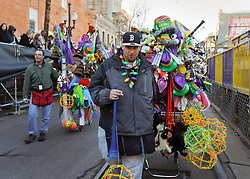 09 February 2016. New Orleans, Louisiana.<br /> Mardi Gras Day. Street vendors with their rigs loaded down with Mardi Gras trinkets make their way along St Charles Avenue in the early morning.<br /> Photo©; Charlie Varley/varleypix.com
