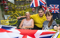 © Licensed to London News Pictures. . LONDON UK.<br /> 7th_JULY_2014.<br />  2014 Tour de France.<br /> The Sewells are prepared outside their florist in Plaistow before Peloton runs through Newham in the East end of London. on the third stage of the race that started in Yorkshire two days before. <br /> Photo credit : ANDREW BAKER/LNP