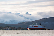 MS Richard With sailing into Herøyfjord, Norway   Hurtigruteskipet MS Richard With seiler inn i Herøyfjord, Norge.  Moltustranda i bakgrunnen.
