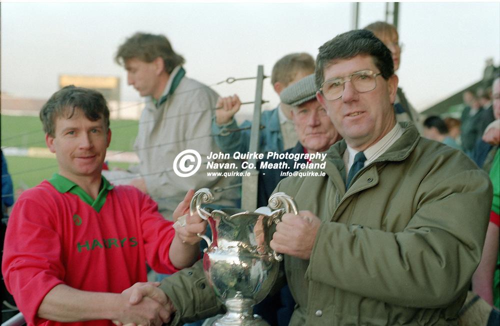 01-12-91. Killyon v Trim - Meath SHC Final at Pairc Tailteann.<br /> Sean Colgan, Chairman Meath Hurling County Board presenting the Meath SHC Jubilee Cup to Killyon captain Paddy Quinn.<br /> Photo: John Quirke / www.quirke.ie<br /> ©John Quirke Photography, 16 Proudstown Road, Navan. Co. Meath. (info@quirke.ie / 046-9028461 / 087-2579454).