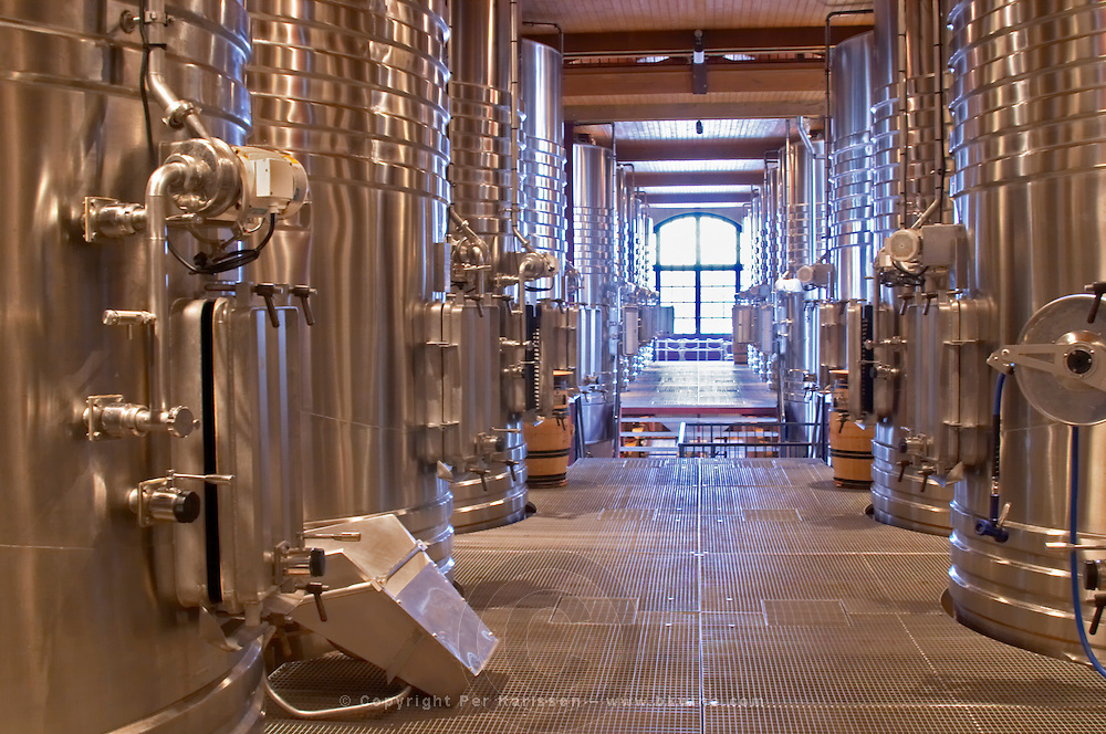 stainless steel tanks  pump fixed on a tank for pumping over chateau haut brion pessac leognan graves bordeaux france