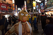 A Man dressed as Kinnikuman during the Halloween celebrations Shibuya, Tokyo, Japan. Saturday October 27th 2018. The celebrations marking this event have grown in popularity in Japan recently. Enjoyed mostly by young adults who like to dress up, drink , dance and misbehave in parts of Tokyo like Shibuya and Roppongi. There has been a push back from Japanese society and the police to try to limit the bad behaviour.