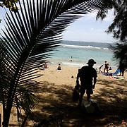 KAUAI, HI, July 12, 2007: Sunbathers enjoy the day at Ke'e Beach on the North Shore of Kauai.(Photograph by Todd Bigelow/Aurora)